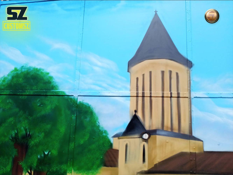 graffeur-professionnel-artisan-graffeur-decoration-mural-mur-paysage-arbre-ville-Surgeres-France-meilleur-graffeur-decorateur